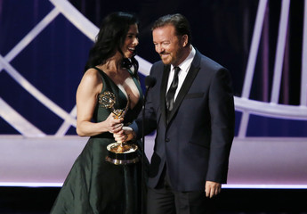 """Ricky Gervais presents the award for Outstanding Writing For A Variety Series to Sarah Silverman for HBO's """"Sarah Silverman: We Are Miracles"""" onstage during the 66th Primetime Emmy Awards in Los Angeles"""