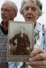 Watt holds a picture of grandfather Mackie while on board the Titanic Memorial Cruise in the mid-Atlantic Ocean