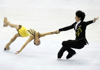 China's Cong Han and Sui Wenjing perform during their pairs free skating segment at the 7th Asian Winter Games competition in Astana