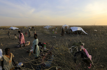 South Sudanese refugees wait inside camp Kilo 10 after arriving from Malakal and al-Rank war zone inside South Sudan, in the al-Salam locality at the Sudan border in White Nile State