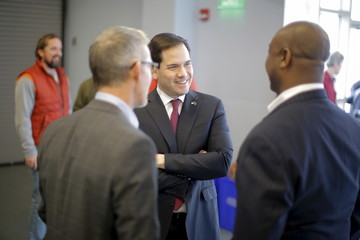 U.S. Republican presidential candidate Marco Rubio talks with U.S. Senator Tim Scott and U.S. Representative Trey Gowdy before a campaign town hall at Francis Marion University in Florence