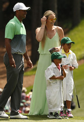 Woods of the U.S. plays the par 3 event with his children and girlfriend Vonn ahead of the 2015 Masters at Augusta National Golf Course in Augusta
