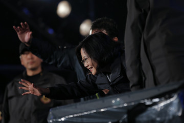 Taiwan's Democratic Progressive Party (DPP) Chairperson and presidential candidate Tsai Ing-wen waves from the stage during a final campaign rally ahead of the elections in Taipei
