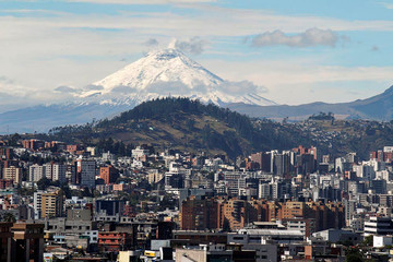 The Cotopaxi volcano spews smoke as seen from north of Quito