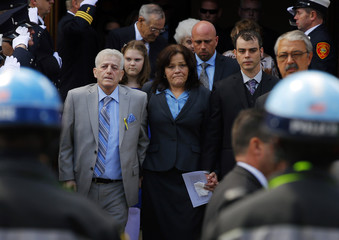 Patty Campbell walks out of the funeral Mass for her daughter Krystle Campbell in Medford