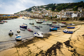 Harbor of  little fishing village Mousehole in Cornwall, UK
