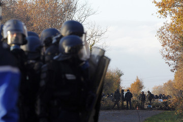 Demonstrators gather on a blockaded country road as evacuation operations continue on land that will become the new airport in Notre-Dame-des-Landes