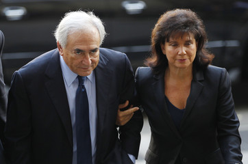 Former IMF Chief Dominique Strauss-Kahn and his wife Anne Sinclair arrive at Manhattan Criminal Court for his arraignment hearing in New York