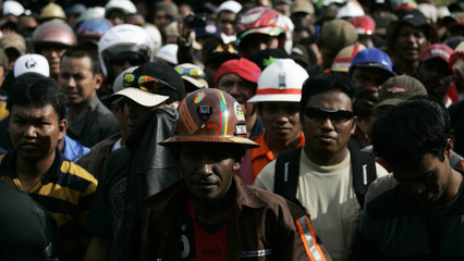 Workers from Freeport McMoRan Copper & Gold stage on a mass strike in the town of Timika in Indonesia's Papua province