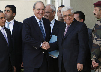 Palestinian President Abbas shakes hands with U.S. Middle East Envoy Mitchell in Ramallah