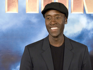 Actor Don Cheadle poses during a photocall for the movie Iron Man 2 in Los Angeles, California