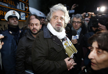Five-Star Movement activist and comedian Beppe Grillo talks with reporters in Pomezia