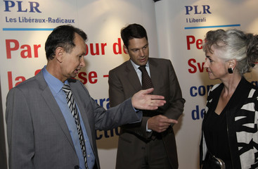 Swiss FDP Party President Mueller speaks with Brupbacher and Walker Spaeh in St-Maurice