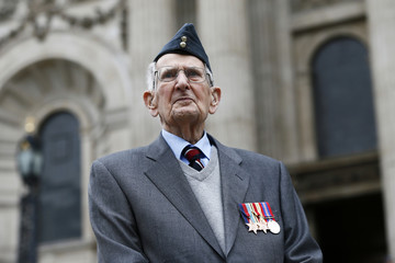 Veteran Clark, 95 poses for a photograph after receiving his campaign medals before a national service of commemoration to mark the 75th anniversary of the Battle of Britain at St Paul's Cathedral in central London