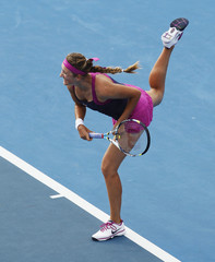 Azarenka of Belarus serves to Jankovic of Serbia during their match at the Sydney International tennis tournament