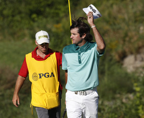Bubba Watson waves after putting on the 18th green to finish his final round of the 92nd PGA Golf Championship at Whistling Straits