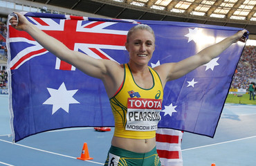 Pearson celebrates finishing second in the women's 100 metres hurdles final during the IAAF World Athletics Championships in Moscow