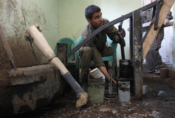 An Afghan man works to make briquettes at the basement of NGO, the Kabul Orthopedic Organization (KOO) in Kabul