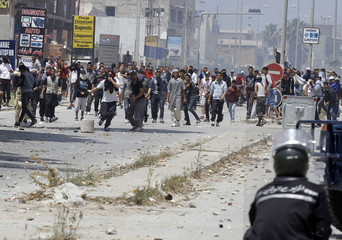 Supporters of Islamist group Ansar al-Sharia clash with riot police at Hai al Tadamon in Tunis