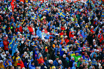 Spectators wait for the start of the men's cross-country 15 km classic and 15 km freestyle skiathlon event at at the Nordic World Ski Championships in Falun