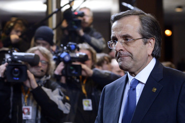 Greece's Prime Minister Antonis Samaras arrives at the EU council headquarters for an European Union leaders summit discussing the European Union's long-term budget, in Brussels