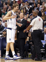 Dallas Mavericks' forward Dirk Nowitzki talks with an official during the second half of their NBA basketball game against the San Antonio Spurs in Dallas