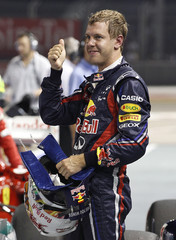 Red Bull Formula One driver Vettel gestures after the qualifying session of the Singapore F1 Grand Prix at the Marina Bay street circuit in Singapore