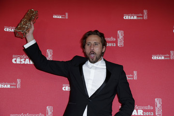 Belgian actor Matthias Schoenaerts poses with his trophy after receiving the Best Male Newcomer Award  during the 38th Cesar Awards ceremony in Paris