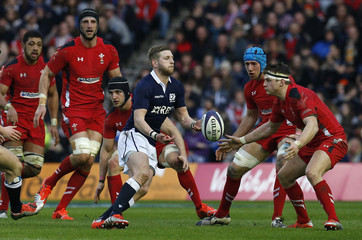Scotland's Finn Russell is confronted by the Welsh defence during their Six Nations rugby union match at Murrayfield Stadium in Edinburgh