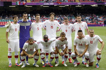 Switzerland's players line-up for team photo before men's first round Group B football match against Mexico in London 2012 Olympic Games in Cardiff