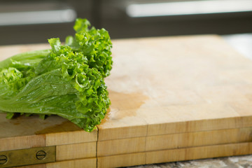 Salas leaves  on rustic wooden table close up with copyspace in the kitchen