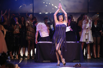 Actress Rossy de Palma presents a creation by Jean Paul Gaultier as part of his Spring/Summer 2014 fashion show during Paris fashion week