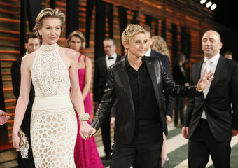 Portia de Rossi and her wife, Oscar host Degeneres, arrive at the 2014 Vanity Fair Oscars Party in West Hollywood