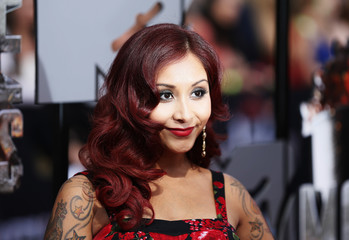 Snooki arrives at the 2014 MTV Movie Awards in Los Angeles