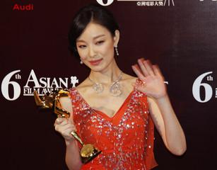 Chinese actress Ni poses after winning the Best Newcomer award at the Asian Film Awards in Hong Kong
