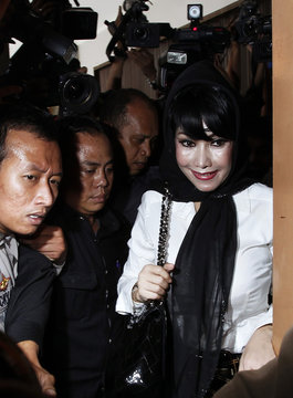 Malinda Dee, a former Citibank relationship manager, arrives at a South Jakarta court
