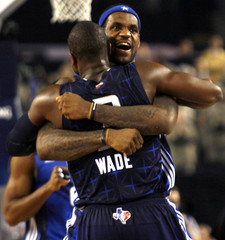 East All-Star LeBron James of the Cleveland Cavaliers hugs East All-Star Dwyane Wade of the Miami Heat in Dallas