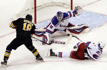 Rangers goaltender Lundqvist blocks a shot on goal by Bruins Seguin as Rangers Del Zotto defends on the play during the second period of their NHL hockey game at TD Garden in Boston