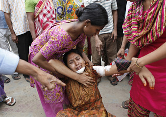 Colleagues rescue Jotsna, a garment worker after she injured by a rubber bullet fired by police during a riot in Dhaka.
