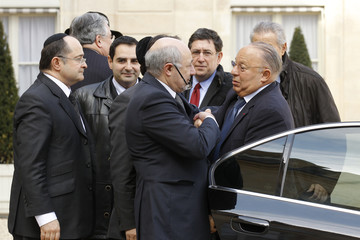 Kalifat, Treasurer of the Representative Council of France's Jewish Associations, shakes hands with Paris Mosque rector Boubakeur as they arrive for a meeting at the Elysee Palace in Paris