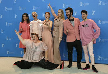 Cast team pose during a photocall to promote the movie 'Skins' at the 67th Berlinale International Film Festival in Berlin