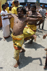"Members of the Indonesian Indian community pierce mouths with rods during ""Pangguni Uttiram"" in Deli Serdang regency"
