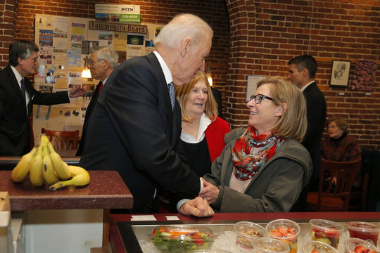 United States Vice President Joe Biden greets diners while ordering lunch at The Works Cafe and Bakery in Concord