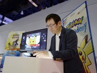 """Tsunekazu Ishihara, president and CEO of The Pokemon Company and producer of Pokemon, tries out the new """"Pokemon Art Academy"""" game during a news conference at E3 in Los Angeles"""