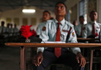 Trainees attend a class during a training session at the training academy of Security and Intelligence Services (India) firm, at Dehradun