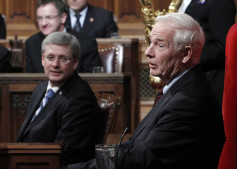 Canada's GG Johnston and PM Harper take part in a Royal Assent ceremony in the Senate chamber on Parliament Hill in Ottawa