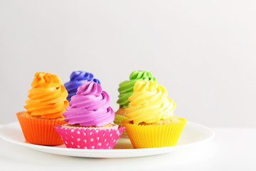 Tasty cupcakes on a white background