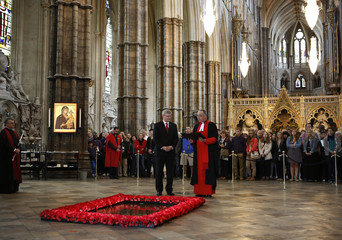 Canada's Prime Minister Stephen Harper stands at the Grave of the Unknown Soldier inside Westminster Abbey in London