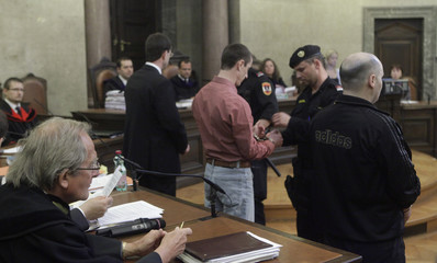 Defendants stand in the dock during a trial in Vienna