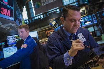 Trader Michael Zicchinolfi works on the floor of the New York Stock Exchange